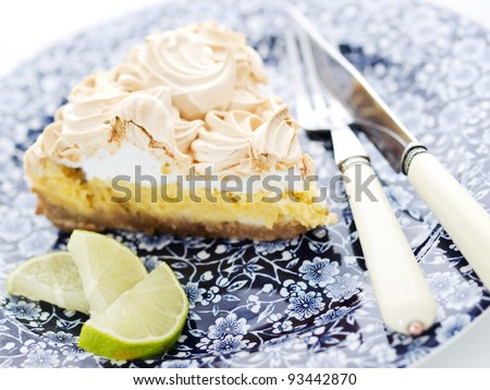 Closeup of a lemon lime pie, dessert with a lime slice - stock photo