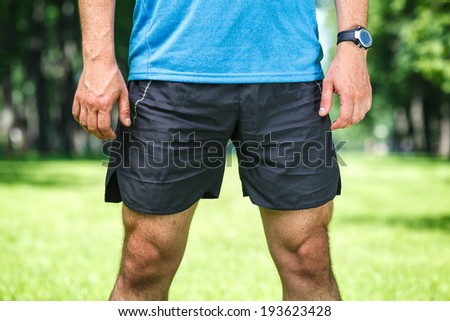 Closeup of a male runner standing - space for text. Fitness concept.