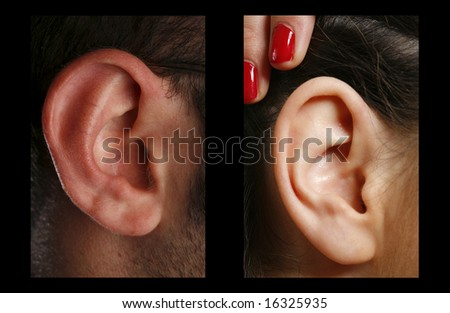 closeup of a man and woman ear in color - stock photo