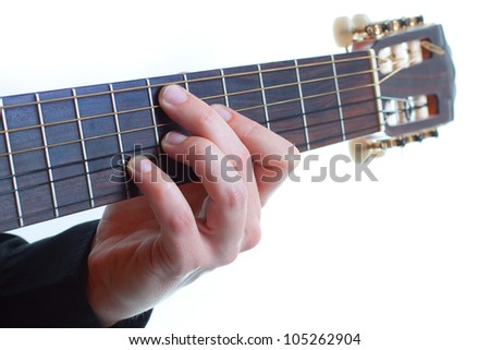 Closeup of a man's fingers playing the guitar - isolated on white - stock photo