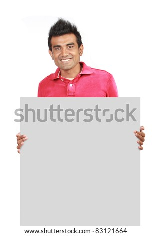 Closeup of a man standing by white blank card - stock photo