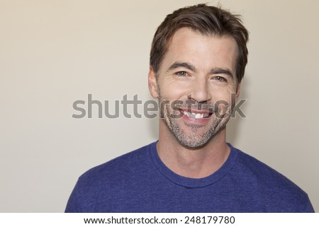 Closeup Of A Mature Man Smiling Isolated - stock photo