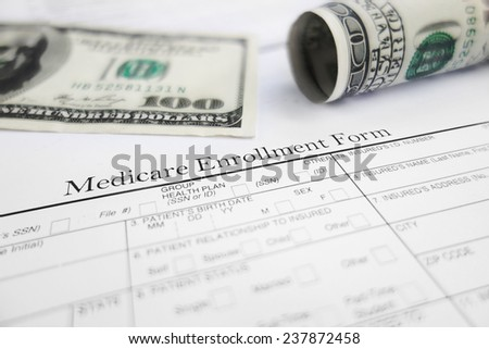 Closeup of a Medicare enrollment form with money