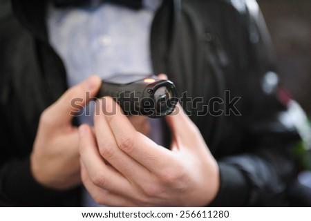Closeup of a mini video camera held in hand - stock photo