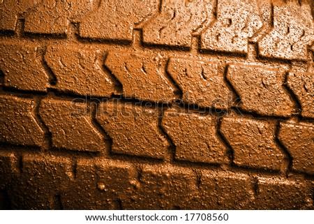 Closeup of a muddy car tire surface - stock photo