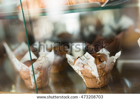 Closeup of a muffin on display in a cafe