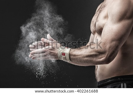 Closeup of a muscular  man ready to workout. Concept image. - stock photo