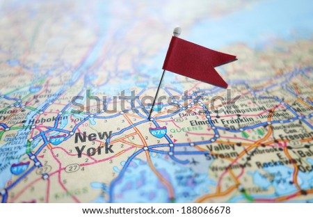 Closeup of a New York City map with red flag                                - stock photo