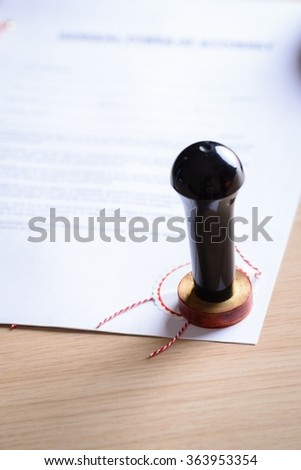 Closeup of a notary stamp on a signed document - stock photo