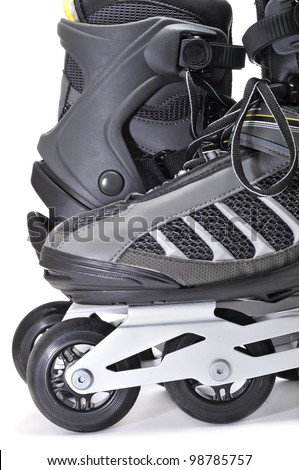 closeup of a pair of inline skates on a white background