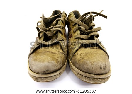 closeup of a pair of worn sneakers - stock photo