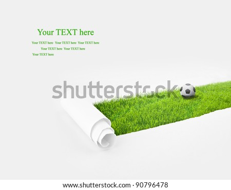 Closeup of a paper hole on grass with ball background