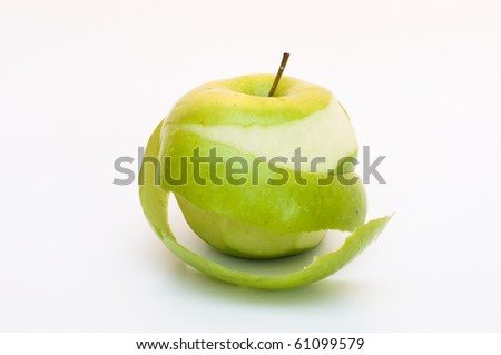 closeup of a partially peeled green apple