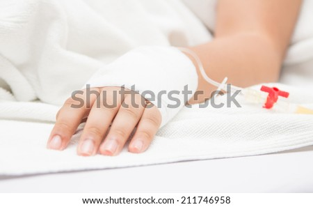 closeup of a Patient hand with Disposable Infusion  - stock photo