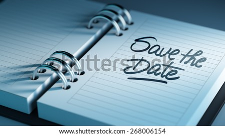 Closeup of a personal agenda marking a day of the month representing a organizing time and schedule. Save the date text note reminder concept. Words Save the date written in Black Marker.
