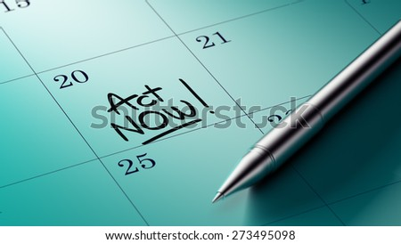 Closeup of a personal agenda setting an important date written with pen. The words Act Now written on a white notebook to remind you an important appointment.