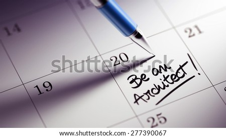 Closeup of a personal agenda setting an important date written with pen. The words Be an Architect written on a white notebook to remind you an important appointment.