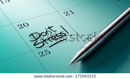 Closeup of a personal agenda setting an important date written with pen. The words Don't Stress written on a white notebook to remind you an important appointment.