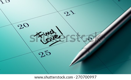 Closeup of a personal agenda setting an important date written with pen. The words Find Love! written on a white notebook to remind you an important appointment.