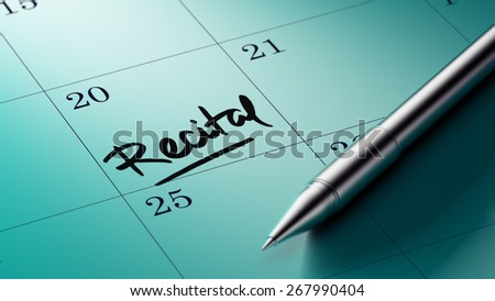 Closeup of a personal agenda with a Ballpoint pen marking a day of the month representing a organizing time and schedule. Recital text note reminder concept. Words Recital written in Black Marker.