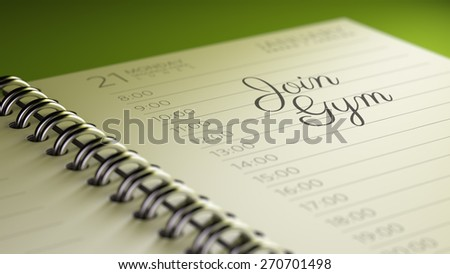Closeup of a personal calendar setting an important date representing a time schedule. The words Join GYM written on a white notebook to remind you an important appointment.
