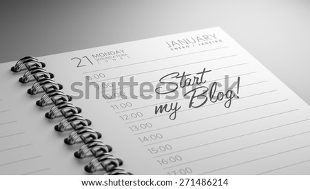 Closeup of a personal calendar setting an important date representing a time schedule. The words Start my Blog written on a white notebook to remind you an important appointment. - stock photo