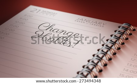 Closeup of a personal calendar setting an important date representing a time schedule. The words Change Habits written on a white notebook to remind you an important appointment.