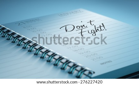 Closeup of a personal calendar setting an important date representing a time schedule. The words Don't Fight written on a white notebook to remind you an important appointment. - stock photo