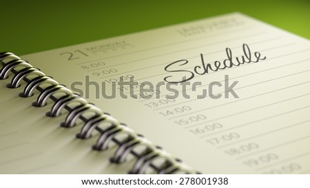 Closeup of a personal calendar setting an important date representing a time schedule. The words Schedule written on a white notebook to remind you an important appointment. - stock photo