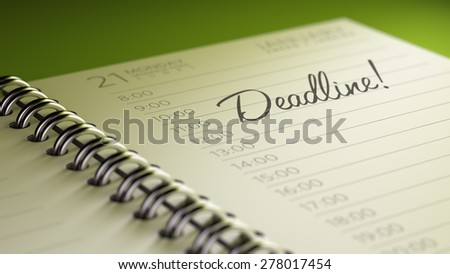 Closeup of a personal calendar setting an important date representing a time schedule. The words Deadline written on a white notebook to remind you an important appointment. - stock photo