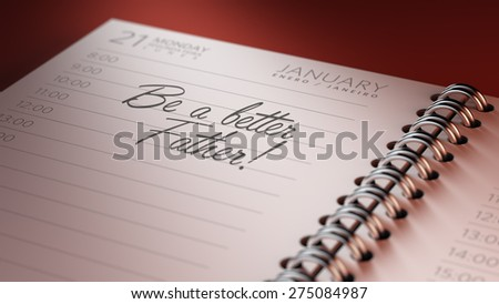Closeup of a personal calendar setting an important date representing a time schedule. The words Be a better father written on a white notebook to remind you an important appointment.