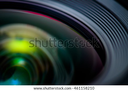 Closeup of a photographic lens with lens reflections