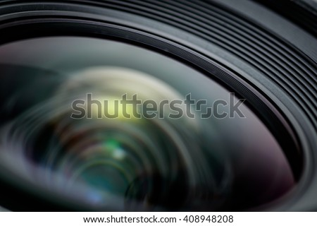 Closeup of a photographic lens with lense reflections