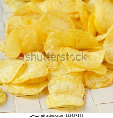 closeup of a pile of appetizing potato chips