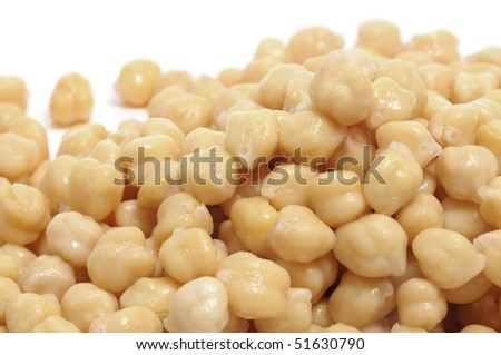 closeup of a pile of chickpeas on a white bacground - stock photo