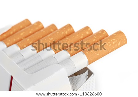 Closeup of a pile of cigarettes isolated - stock photo