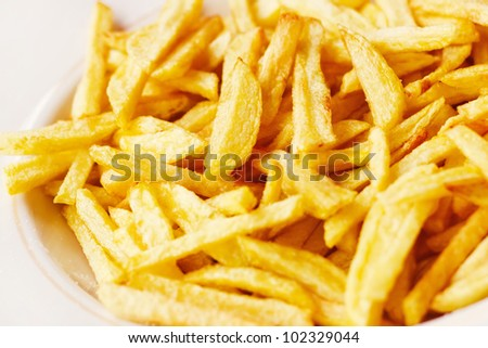 Closeup of a pile of french fries (shallow dof) - stock photo
