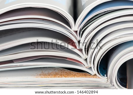 Closeup of a pile of magazines - stock photo