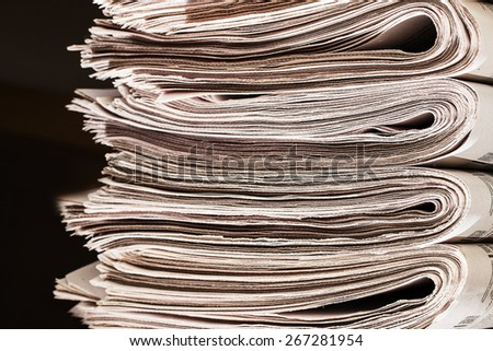Closeup of a pile of newspapers.  A pile of newspapers - stock photo