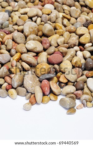 closeup of a pile of pebbles on a white background - stock photo