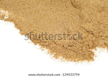 closeup of a pile of sand on a white background - stock photo