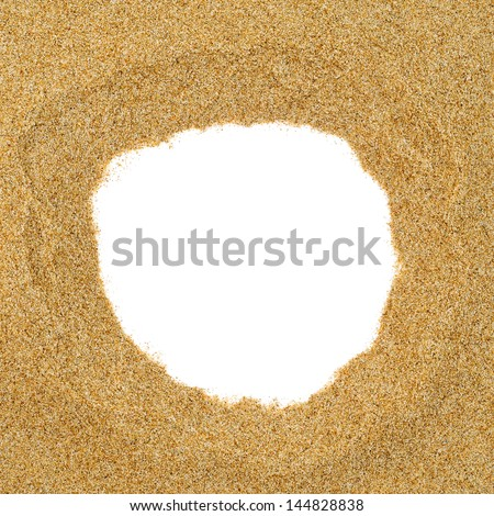 closeup of a pile of sand with a round hole in the middle on a white background, as a frame - stock photo