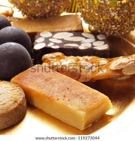 closeup of a pile of turron, mantecados and polvorones, typical spanish christmas sweets - stock photo