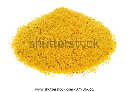 closeup of a pile of uncooked spiced couscous