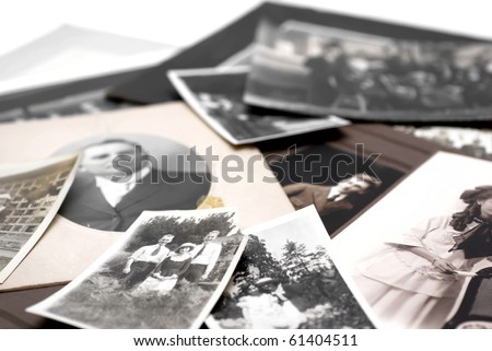 Closeup of a pile of vintage family photos - stock photo