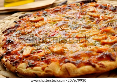 closeup of a pizza with chicken and vegetables - stock photo