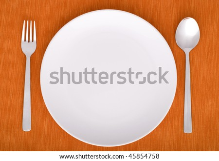 closeup of a place setting with dinner-plate - stock photo