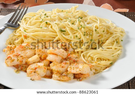 Closeup of a plate of shrimp scampi with pasta