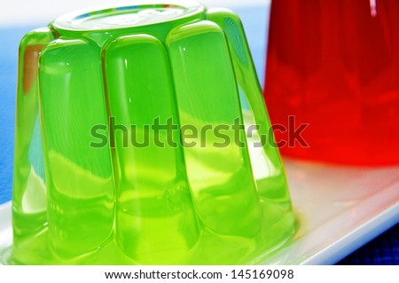 closeup of a plate with refreshing gelatin desserts of different flavors and colors - stock photo