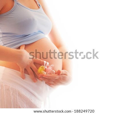 closeup of a pregnant woman holding two dummies - stock photo